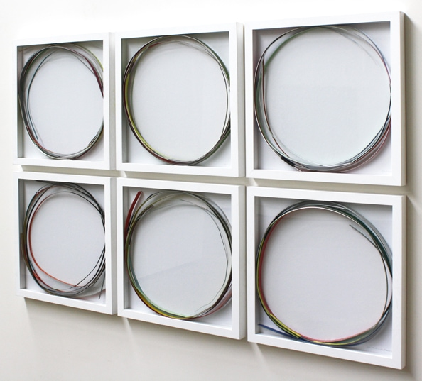 SIX-PAC No. 2/10', 2011, metal stripes in vitrine, 6 panesl, each 55 x 55 x 5 cm