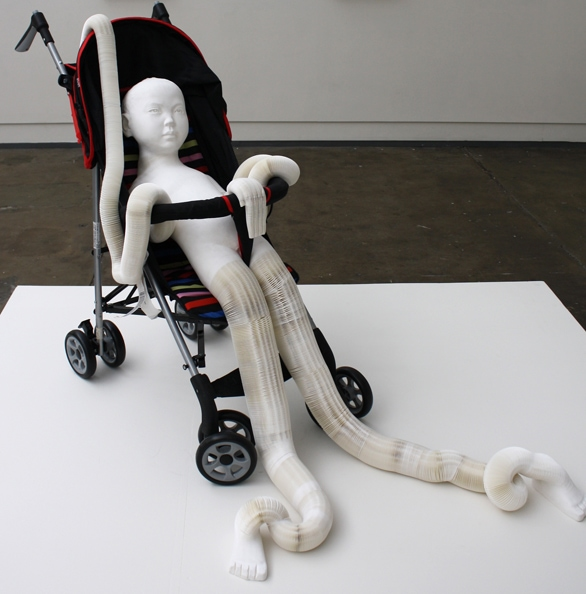 'Baby', 2012, paper, glue, pram, compounded 85 x 26 x 18 cm, edition of 1