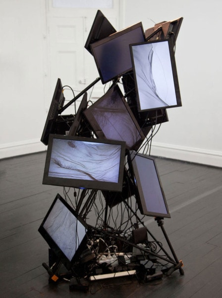 'Another self portrait', 2014. 14-channel video installation, 180 x 80 x 80 cm, Edition 2 + 1 a.p. <br />