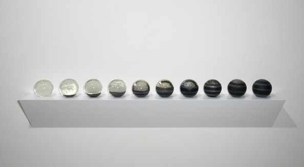 Tsukimi with Rings: Suite No. 1, 2012, solid glass spheres on timber wall mounted plinth, 58 x 200 x 20 cm