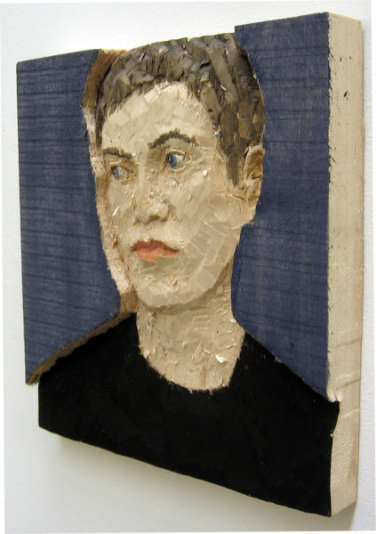 Exhibition shot of 'Man with black hair', 2008, poplar wood, paint, 28 x 30 x 4 cm