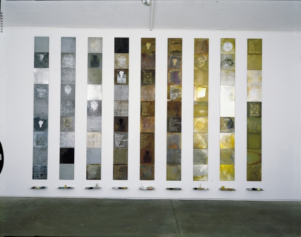 title_ Solids by Weight Liquids by Measure (alchemical plates from the Periodic Table series), 1993, seven metals, oil, various substances and laboratory glass, 3 x 5 m