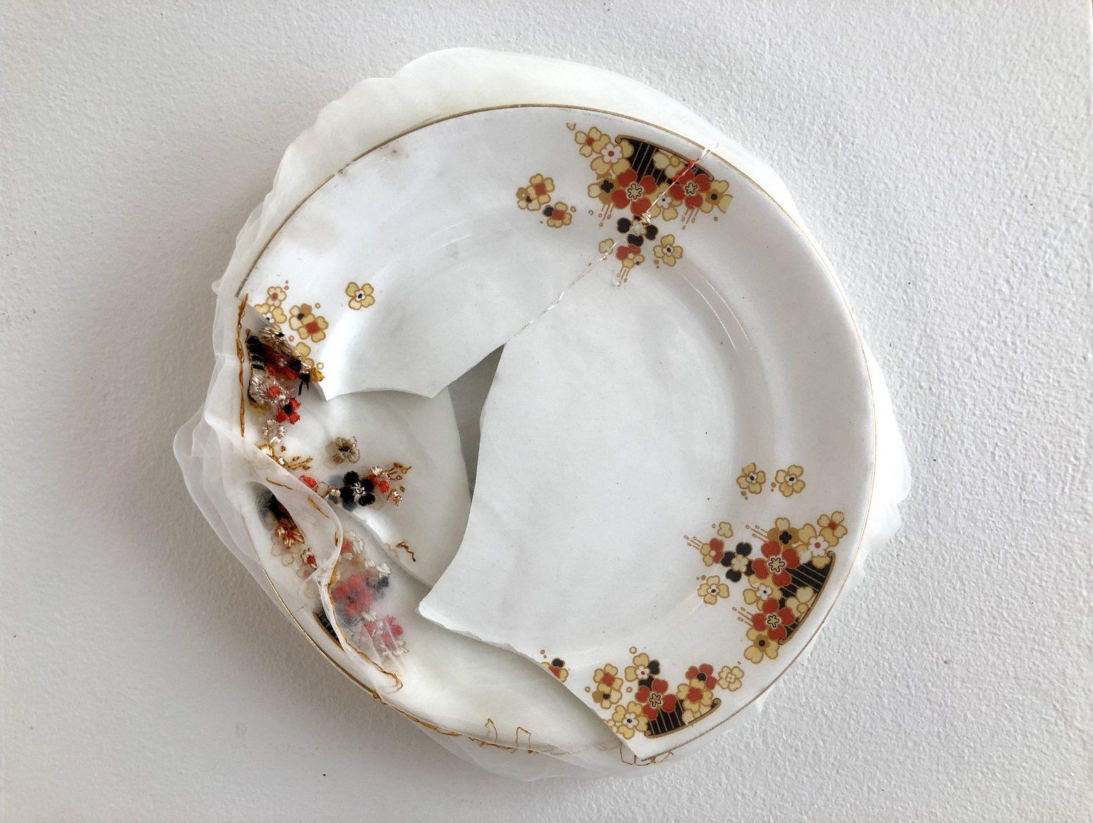 'Renovated orange plate', 2015, Italian synthetic cloth, ceramic, Japanese silk thread, 24 cm diameter