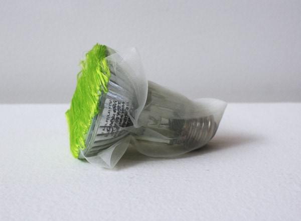 'Green light bulb', 2015, light bulb, Italian synthetic cloth, Japanese silk thread, 8H x 8D cm