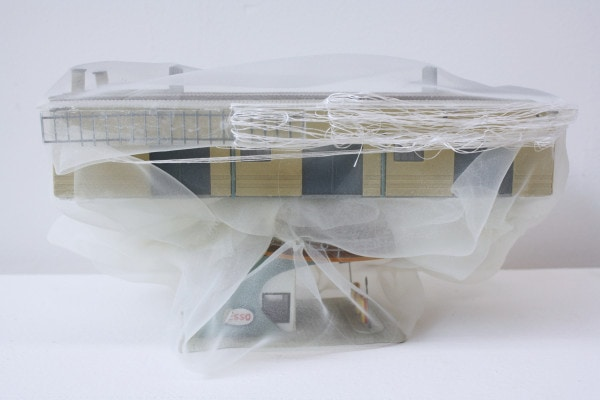 'Renovated buildings GUTANNAHME-ESSO', 2014, broken German model buildings, Italian synthetic cloth, Japanese silk thread, 25 x 15 x 19 cm