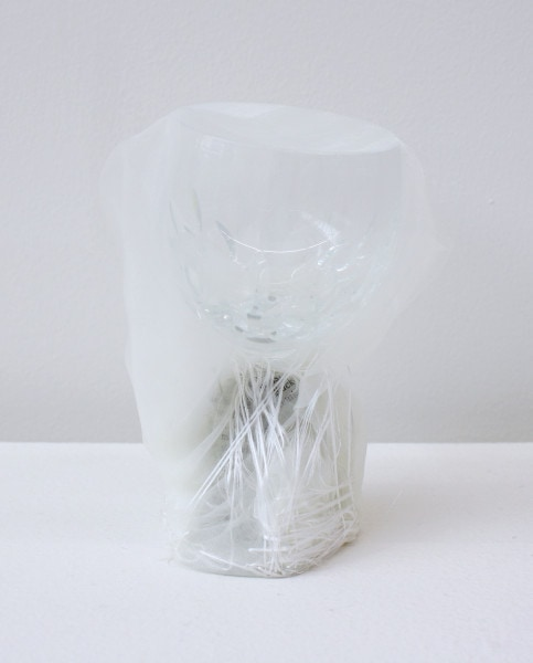 'Renovated glass (with hand picture of fighting)', 2015, glass, Italian synthetic cloth, Japanese silk thread, 13H x 7D cm