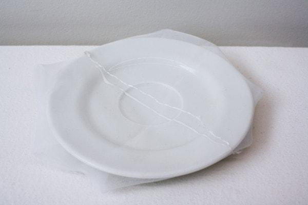"""Renovated K.K.'s soup dish', 2013, ceramic dish, Italian synthetic cloth, Japanese silk thread, 2H x 16D cm"