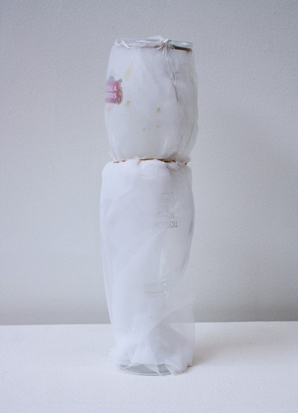 'Drank with dearest you then capped', 2006, Stella Artois glass, Italian synthetic cloth, Japanese silk thread, 30H x 8D cm