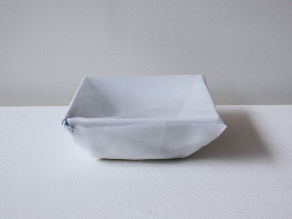 'K.K.'s square dish', 2007, ceramic bowl, Italian synthetic cloth, Japanese silk thread, 15 x 15 x 4 cm