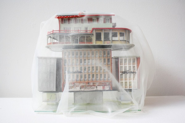 'Renovated buildings HELVETIA VERSICHER', 2014, broken German model buildings, broken mirror, Italian synthetic cloth, Japanese silk thread, 25 x 25 x 18 cm,