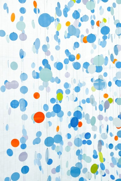 Colours are the Country, 2014, stainless steel 2pak enamel discs, stainless steel cable, 27 x 6 x 4m. Photo: Flashpoint Lab
