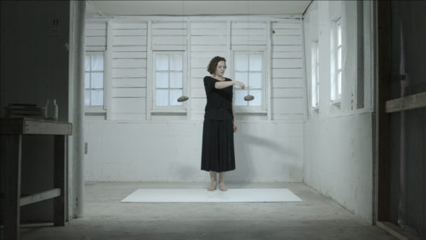 'Cleave', 2018, single channel high definition video, 29 seconds, from installation in two parts + action for one person. Developed and performed at Art Omi Artists Residency. Performer: Emma Fielden. Filmed by Orkhan Huseynov.