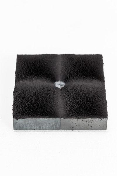 TERRAIN I', 2016, iron oxide pigment, ferrite magnets, steel, 10 x 10 cm