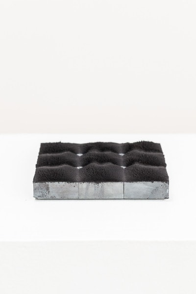 `TERRAIN II', 2016, iron oxide pigment, ferrite magnets, steel, 15 x 15 cm
