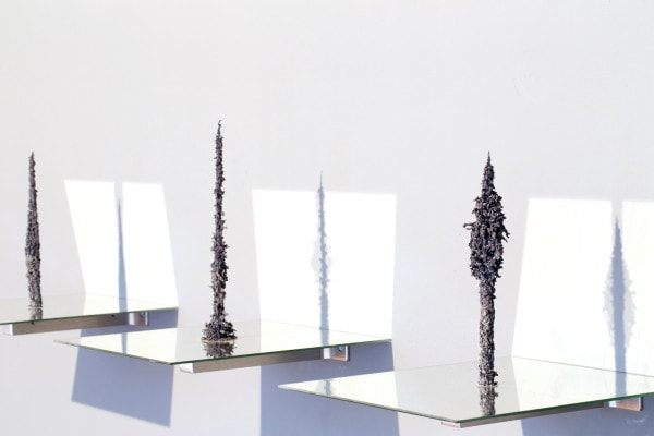 'Axis Mundi: The Point', 2015, crushed ferrite ceramic magnets, neodymium magnets, glass mirror, dimensions variable