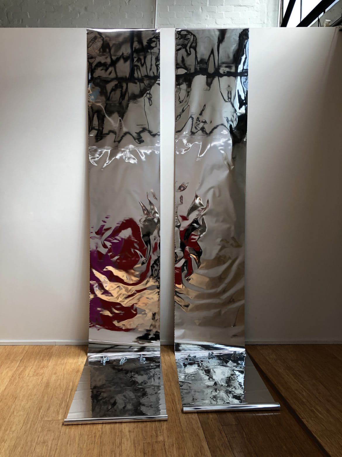 'Cold  Front', 2018,  cellophane, amplifier, speaker,  media player, 340 x  71cm.