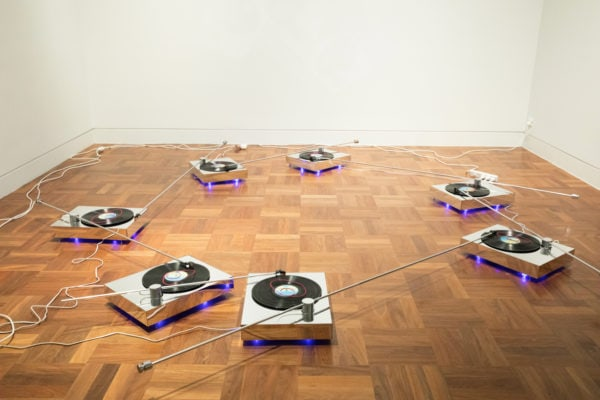 'Future Tense',  2018, turntables,  mirrored acrylic,  metal, vinyl  records, timer,  dimensions  variable, unique  sets of 2,3,4,5,6  or 7 available.