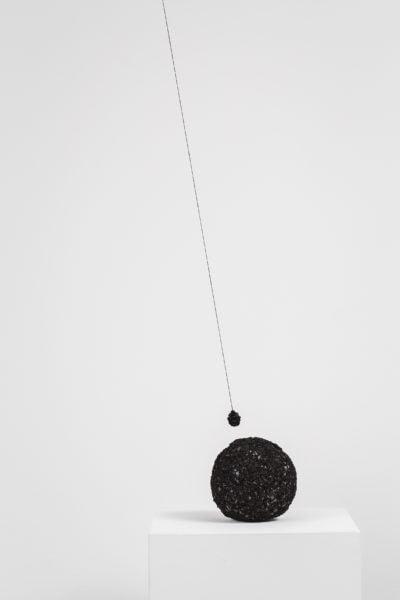 'Orb',<br /> 2017, hand crushed ferrite magnets, iron oxide pigment, rare earth magnets, linen thread.<br />