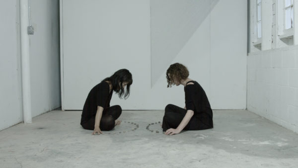 'We are two molecules floating together in space and our distance is infinite… then the sound of birds',<br /> 2018, single channel high definition video, 5 minutes 26 seconds, from installation in two parts + action for two people. Developed and performed at Art Omi Artists Residency. Performers: Emma Fielden and Hanae Utamura. Filmed by Orkhan Huseynov.<br /> <br />