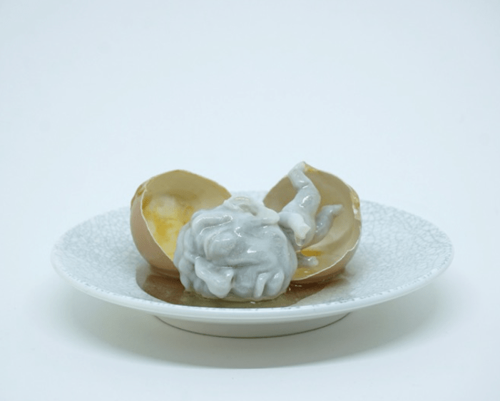 Gary Deirmendjian, 'fat head-yolk', 2016, 3D printed human form, resin encasement, egg shell, plate, 6 x 15 x 15cm, unique