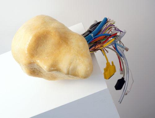 Gary Deirmendjian, 'unplugged', 2011, slip cast ceramic head form, resin encasement, other media, 18 x 28 x 17 plus cable dimensions variable