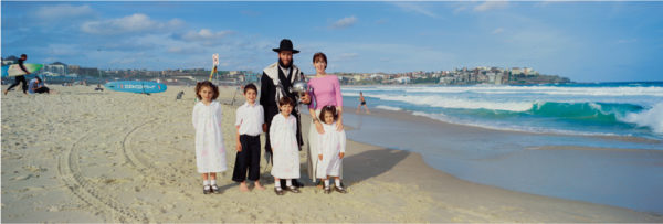 Rabbi + family Rabbi Mendel Kastel his wife, Tzippy, their son Shui, and daughters, Rivky, (left) Dassi and Tovi (far right), 2001<br />