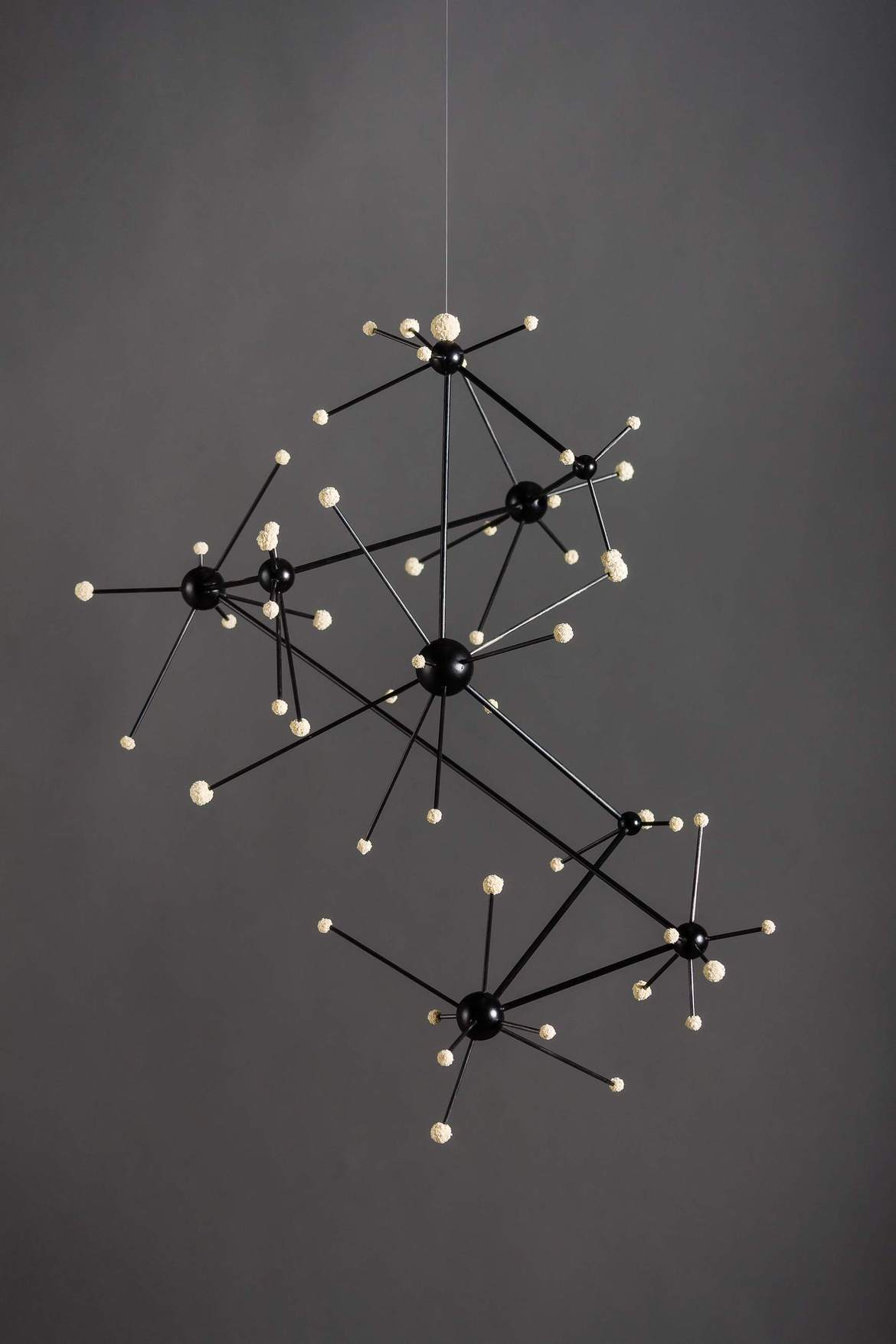 'COSMIC CONNECTION', 2013, wooden spheres, glass fibre rods, foam rubber balls, nylon filament, approximately 32 x 32 x 32 cm