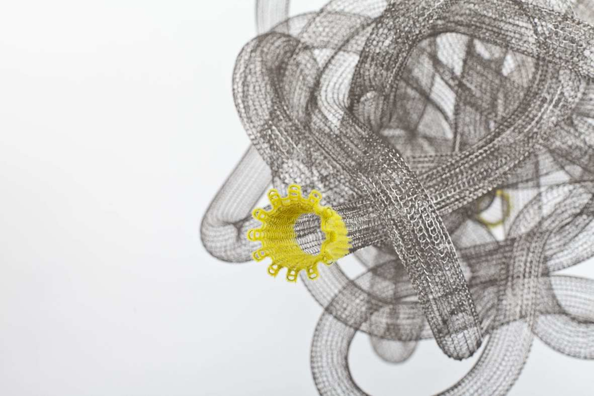 'SPACE KNOT - WORMHOLE No.3'(detail), 2011, 22 mm stainless steel knitted tubing, stainless steel thread, yellow nylon flock, nylon filament,<br /> 33 x 43 x 33 cm