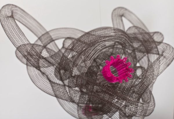 'TIME LOOP - WORMHOLE No.2' (detail), 2011, 22 mm stainless steel knitted tubing, stainless steel thread, neon pink nylon flock, nylon filament,<br />