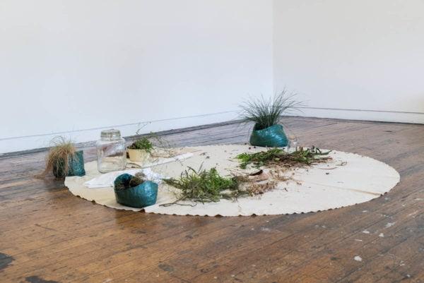 'muhlu garrwarn / cool time hot time', 2018, bush-dyed silk, cotton and thread, yirrarla (calico), cardboard, glass jars, bawa (water), watharn (green leaves), birditha (dry leaves), jurdubirri (native flower), burlaawa (non-native flower), birra (bark), dimensions variable. Photograph by Simon Strong.
