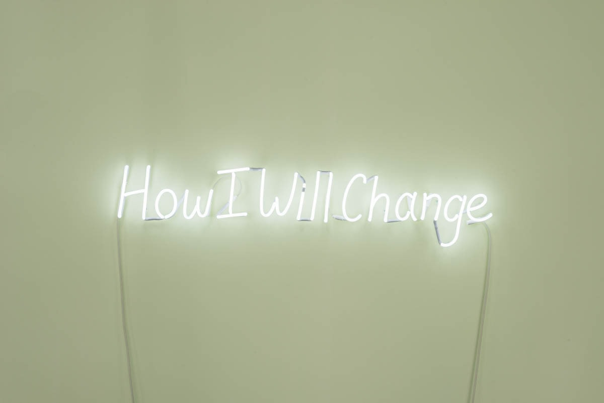 'How Will I Change', 2018, neon sign, 20 x 135 cm<br /> Photograph: Simon Strong